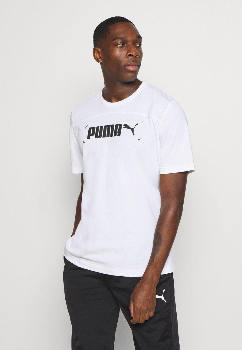 Puma - NU TILITY GRAPHIC - T-shirt med print - white