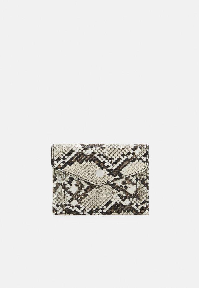 Business card holder - beige