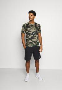 Nike Performance - SLIM CAMO - Print T-shirt - galactic jade/baroque brown - 1