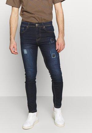 COVE - Jeansy Skinny Fit - dark blue denim