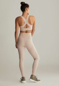 OYSHO - Medium support sports bra - beige