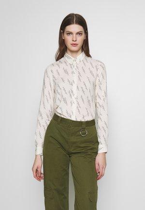 VMGUNHILD - Button-down blouse - nude