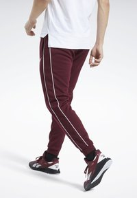 Reebok - WORKOUT READY JOGGERS - Tracksuit bottoms - burgundy - 2