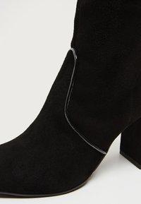 faina - High heeled boots - black - 6