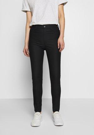 SHANNON - Trousers - black
