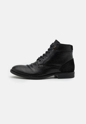 OLIELLE - Lace-up ankle boots - black