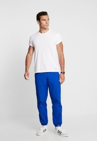 adidas Originals - BALANTA TP - Trousers - collegiate royal - 1