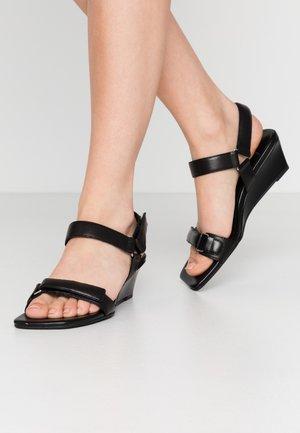 NELLIE - Wedge sandals - black