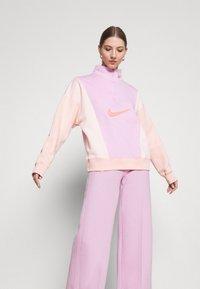 Nike Sportswear - PANT - Tracksuit bottoms - light arctic pink - 3