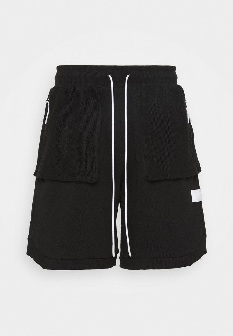 Puma - STANDBY SHORTS - Sports shorts - black