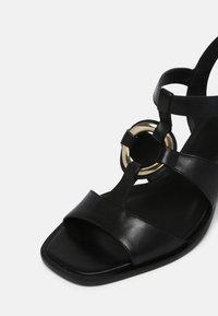 Minelli - Sandaalit nilkkaremmillä - noir - 7