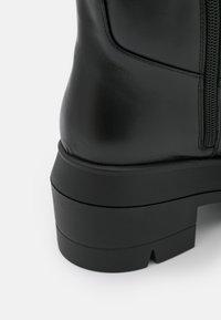 Stuart Weitzman - NORAH TALL BOOT - Platform boots - black - 5