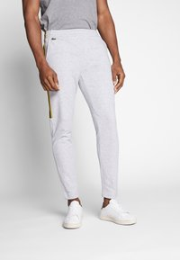 Lacoste - Tracksuit bottoms - silver chine/jonquille-black - 0