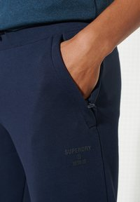 Superdry - Tracksuit bottoms - nautical navy - 0