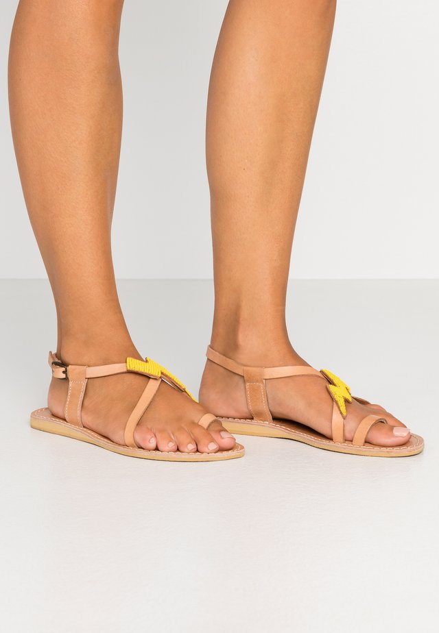 ICINI FLAT - T-bar sandals - light brown/yellow