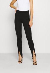 NA-KD - FRONT SLIT PANTS - Trousers - black - 0