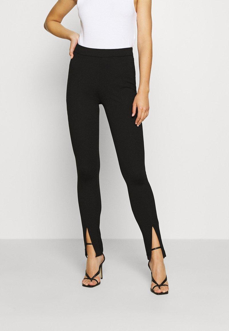 NA-KD - FRONT SLIT PANTS - Trousers - black