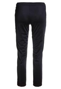 Puma - LIGA TRAINING PANTS CORE  - Tracksuit bottoms - black/white - 1