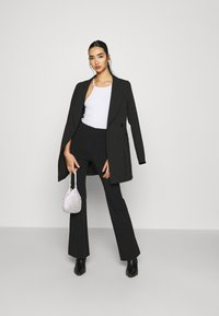 Monki - VIOLET TROUSERS - Trousers - black dark - 1