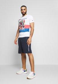 Champion - ROCHESTER ATHLEISURE - Pantalón corto de deporte - dark blue - 1