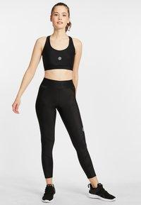 Skins - SKINS SPORT-BH S3  - Sports bra - black - 1