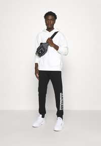Versace Jeans Couture - Tracksuit bottoms - nero - 5