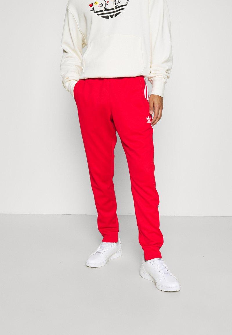 adidas Originals - Spodnie treningowe - red/white