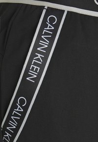 Calvin Klein Performance - PANTS - Tracksuit bottoms - black - 7