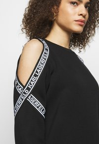 KARL LAGERFELD - COLD SHOULDER DRESS - Denní šaty - black - 4