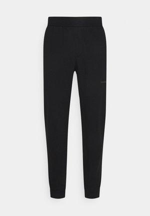 OFF PLACED ICONIC PANT - Verryttelyhousut - black