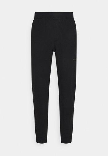OFF PLACED ICONIC PANT - Pantaloni sportivi - black