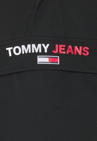 Tommy Jeans - SOLID POPOVER JACKET UNISEX - Windbreaker - black - 2