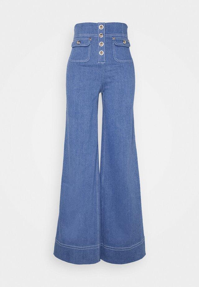 WOODSTOCK PANT - Široké džíny - denim