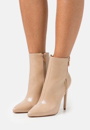 ROOKY - Classic ankle boots - nude
