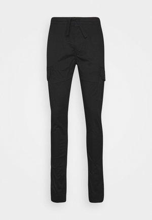 CAKA CARGO PANT - Pantalones chinos - black