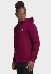 adidas Performance - MUST HAVES FULL-ZIP STADIUM HOODIE - Zip-up hoodie - purple - 2