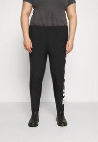 Nike Sportswear - Leggings - Trousers - black - 0