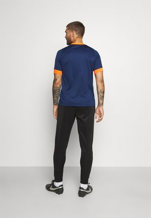 CHALLENGE - Pantaloni sportivi - schwarz/neonorange
