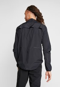 Craft - ADOPT RAIN JACKET - Regnjakke - black - 2