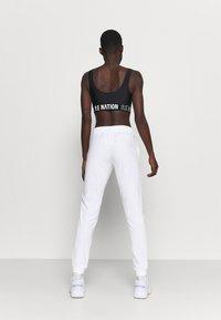 Champion - RIB CUFF PANTS - Verryttelyhousut - white - 2