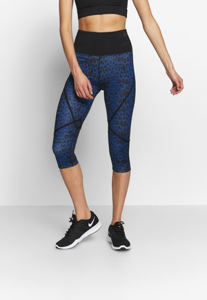 EXCLUSIVE TO ZALANDO PAINTED LEOPARD CROPPED LEGGINGS - Leggings - blue