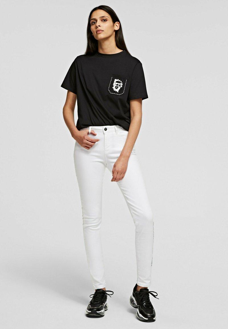 KARL LAGERFELD - Trousers - white denim