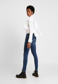 Diesel - SLANDY LOW - Jeans Skinny Fit - indigo - 2