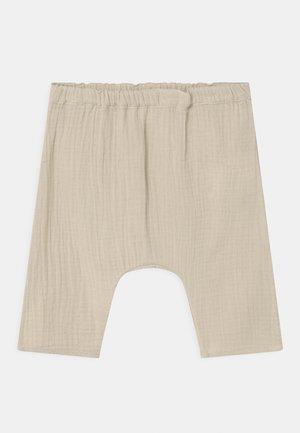 UNISEX - Trousers - beige