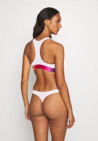 Calvin Klein Underwear - PRIDE UNLINED BRALETTE - Alustoppi - white - 2