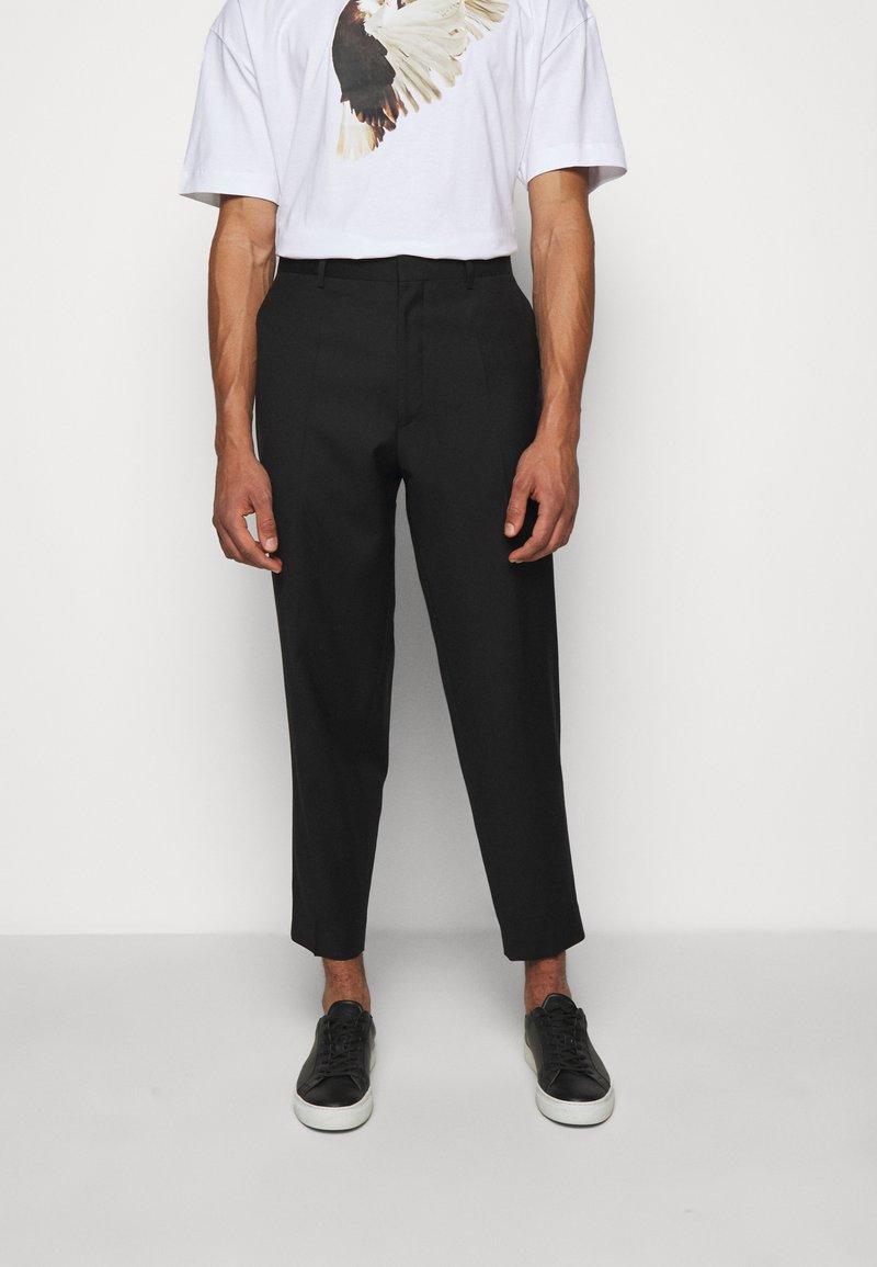 Études - REVOLTE UNISEX - Pantalon classique - black