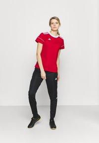 adidas Performance - TIRO  - Pantalones deportivos - black - 1