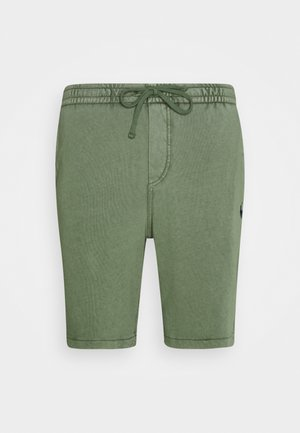 TERRY - Tracksuit bottoms - green