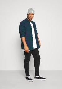 Jack & Jones - JJILIAM JJORIGINAL - Jeans Skinny Fit - black denim - 1