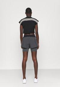 adidas Performance - RECCO CROP TEE - Triko spotiskem - black - 2